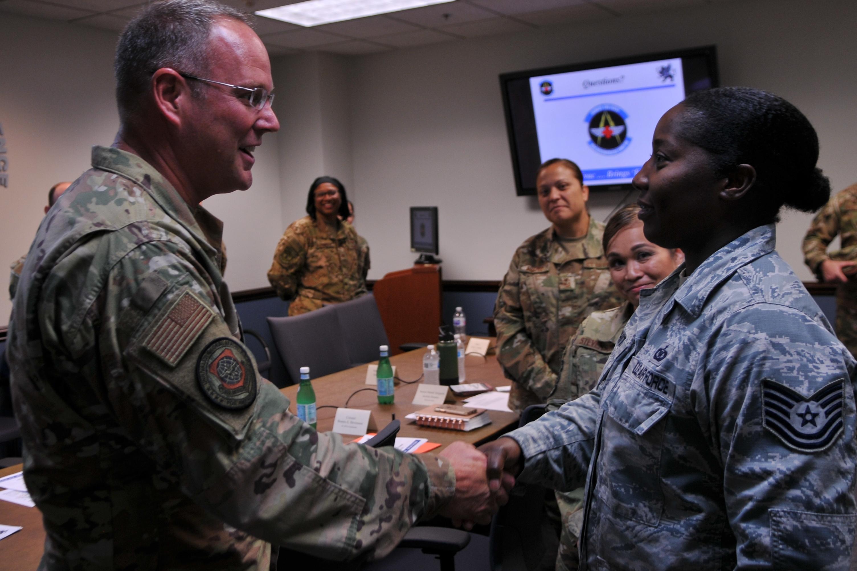 Lt Gen Thomas and CMSgt Berg visit Pope Airmen